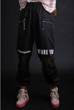 מכנסים שחורים בשילוב בד רשת WE ARE