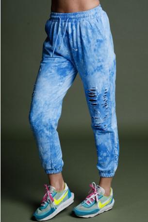 מכנסי טרנינג קרעים טאי דאי בגוון תכלת שטוף NY