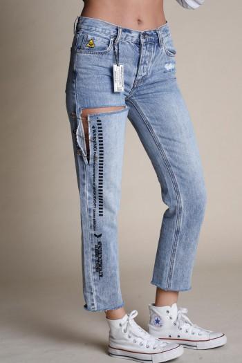 מכנסי ג'ינס בגזרה נמוכה קרעים WARNING